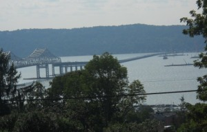 A partial view of the bridge and the river, including now-familiar floating machinery, seen from Tarrytown.