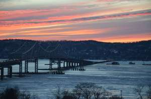 The contrast between nature's magnificence — this January 27 sunset, seen from the EarthCam® construction camera in Tarrytown — and activity in the river speaks for itself.