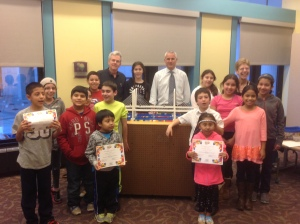 Educ. Outreach Administrator Andy O'Rourke and Special Project Advisor Brian Conybeare with LEGO® Build Club Members and children's librarian Terry Rabideau at White Plains Public Library/Courtesy of NNYB Team Outreach
