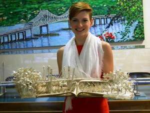 "Jodi Harvey-Brown with ""Imagination's Journey,"" her book sculpture of the New NY Bridge/© Janie Rosman 2014"