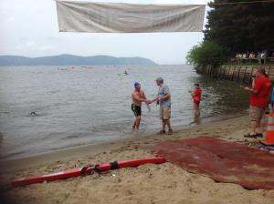 Peter Sanderson completes swim/New NY Bridge Outreach