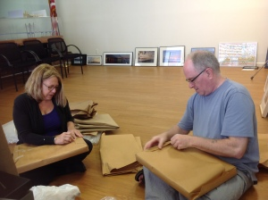 Visual Quality Panel member Heather Sporn and Hultberg unwrap artists' entries in Nyack/New NY Bridge Outreach