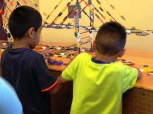 Youngsters carefully study the model bridge before selecting their K'NEX pieces/White Plains Public Library