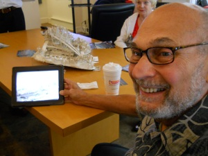 Dominick Minotti looks at picture of the Luke Estate, where he lived in high school, before the TZB/© Janie Rosman 2014
