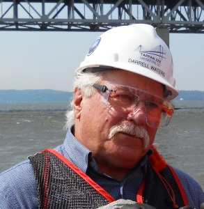 Darrell Waters updates reporters during a July media boat tour of the NNYB project site/© Janie Rosman 2014