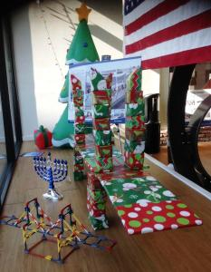 Christmas bridge and tree, Hanukkah menorah in window of Nyack Outreach/NNYB Outreach
