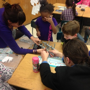 Building a LEGO® model of the new bridge takes teamwork and concentration - go kids!/Asst. Principal Peter Kilgallen