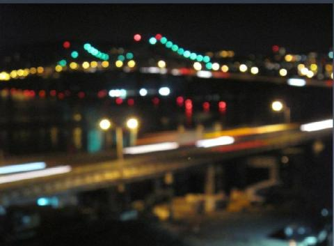 Dancing lights are early-morning vehicles and bridge/EarthCam® construction camera