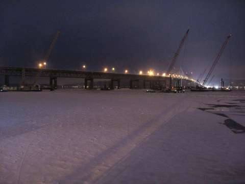 Lights and equipment creating shadows on the river ice/EarthCam® construction camera