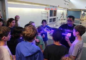 Kids examine a mini drone before it attempts to maneuver its way around an obstacle course/Photo by Amanda Lai