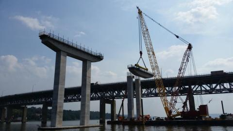 Pier cap placement continues; crews start work on the 419-foot main span towers/NNYB