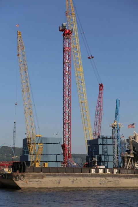 Crews can safely create the new bridge's towers using tower cranes and catwalks/NNYB