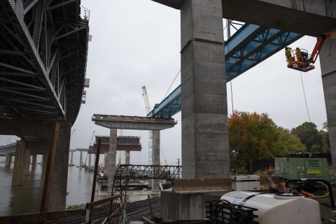 A massive girder assembly successfully installed over Metro-North train tracks./NYSTA