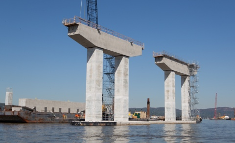 Piers are topped w/prefabricated caps prepared offsite and delivered via barge/NYSTA