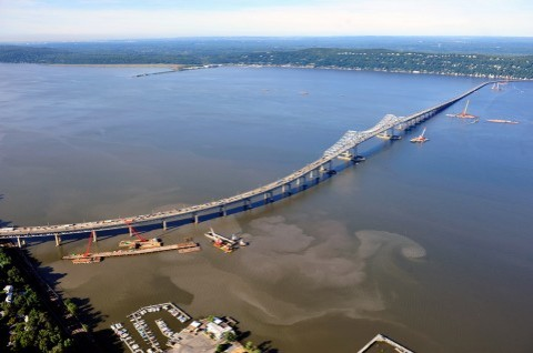These aerial photos taken in 2013 and 2015 show how Tappan Zee Bridge project activities have caused the resuspension of bottom sediments, causing plumes of turbid water, in visible contrast to natural conditions of the Hudson River estuary./Lee Ross