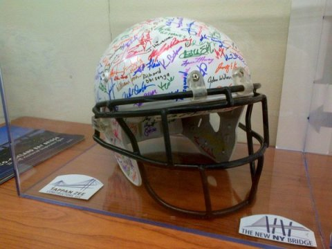 Commemorating Super Bowl XLIX (2015) and project staff with this signed helmet/NNYB