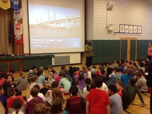 Greenvale principal Darrell Stinchcomb tells 4th-grade classes the new bridge is part of the area's history/NYSTA