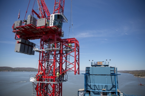 Securely fastened with safety equipment and working on main span tower crane/NYSTA