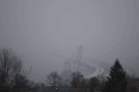 Disappearing bridge hidden in clouds and fog right before it began to snow./EarthCam®